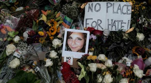FILE PHOTO: A photograph of Charlottesville victim Heyer is seen amongst flowers at the scene of the car attack on a group of protesters in Charlottesville