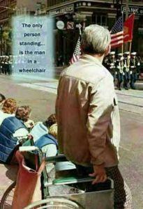 wheelchair vet stands for flag