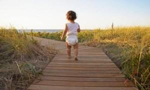 baby walking beach